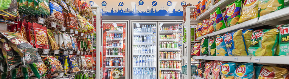 An image of inside of a convience store looking down a snack asile