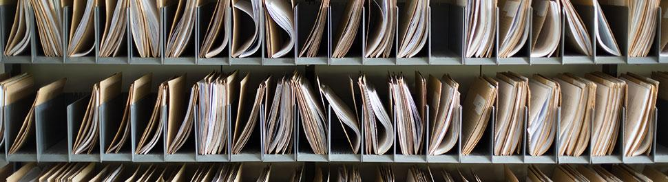 Image of a row of open file cabinates with files