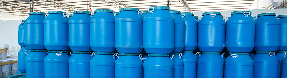 Image of a stack of blue plastic pesticide containers